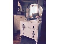 Old vintage shabby chic dressing table with mirror