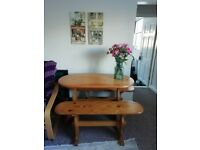Oval dining table with two benches