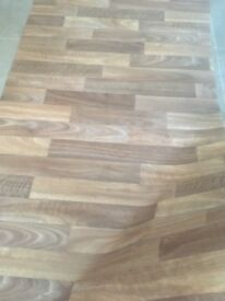 Wood effect off cut Lino. Suitable for utility area or small space