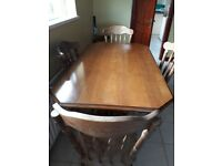 Solid dining room table with 4 chairs