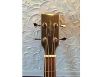 Tanglewood acoustic Bass guitar.