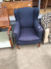 Ladies wingback armchair , covered in tartan material . Really comfy . Free local delivery.