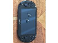 PS Vita Slim plus Two 8gb Memory Cards. As new condition with charger.