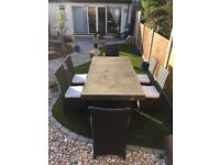 Large concrete topped garden table and six ratten chairs with cushions