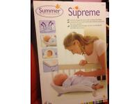 Baby sleep positioner with heartbeat