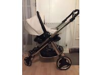 Fantastic condition, modern white leather style travel system. Car seat, carrycot and pushchair
