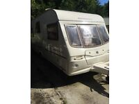 Touring caravan. 4 berth with fixed bed comes with awning