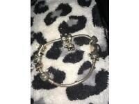 Pandora bracelet with 8 charms