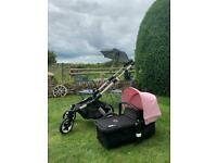 Bugaboo Buffalo pushchair and carry cot in black and pink hood with accessories