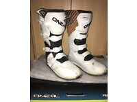 White Oneal motocross boots.