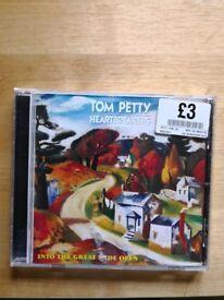 Tom Petty greatest hits CDs. 50p