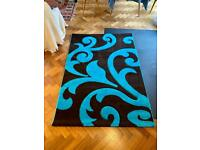 Dark brown and turquoise rug