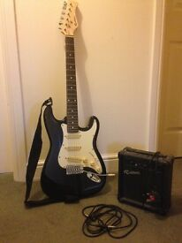 Electric guitar for sale, comes with an amplifier and protective bag.