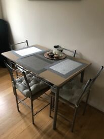 Dining table and 4 chairs with seat pads