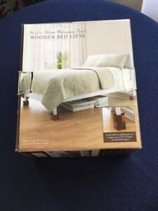 Set of 4 wooden bed lifts. Price $12.00.    403-346-2511