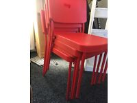 4 red stackable seats/ chairs plastic