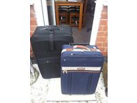 1 LARGE 1 MED SUITCASES AS NEW