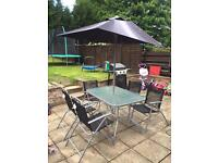 Garden table and 6 chairs & parasol