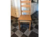 4 x Oak effect wooden dining chairs.