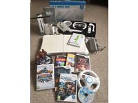 MASSIVE Wii Bundle - Wii Console + Controllers + Games + MARIO KART + Skylanders + Fit Board + More
