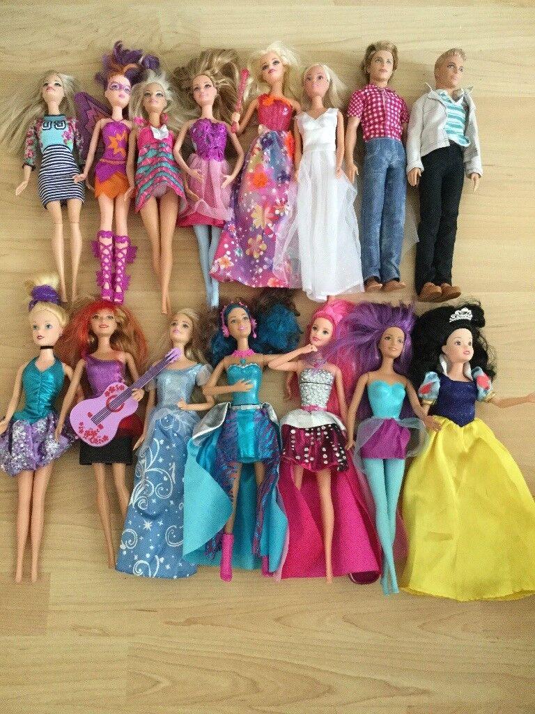 Bundle of 13 Barbie Dolls and 2 Ken Dolls