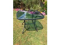Glass / Metal blue patio table with parasol. 35 in square. central hole for parasol