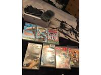 PSP with holder and charger and games and movies