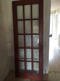 Internal door with glass panels