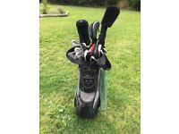 Full set of Mizuno T-Ziod golf clubs complete with driver, 3&5 woods, putter, bag, etc.