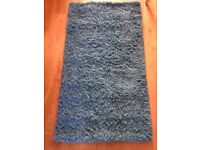 Teal fluffy rug brand new unused 120x65cm