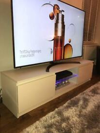 Large white Tv table with led lights