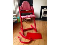 Vintage red Stokke Tripp Trapp high chair with striped cotton covers