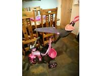 Pink trike with parent handle