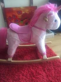 Child's unicorn rocking horse