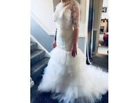 Brand new size 14 wedding dress. Only tried on. Cost £1,200 new