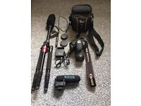 Canon EOS Rebel T5i with Caseflex tripod/monopod, Rode mic, and Camera bag