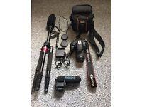 Canon EOS Rebel T5i with Caseflex tripod/monopod, Rode mic, 64 GB SD card and Camera bag