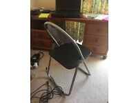 Foldable chair w/ black padding
