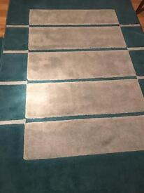 2x Teal/turquoise rug