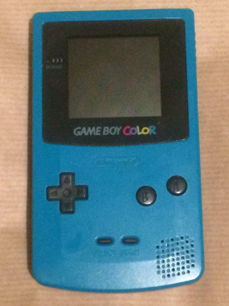Gameboy Colour with organiser case, mains plug & 5 games