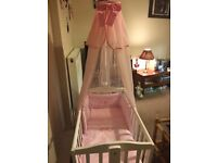 White crib with handmade pink drapes and bumper set. Used a handful of times only.