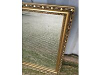 A Vintage Gold Coloured Large Wall Mirror