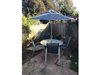 Garden table,chairs and parasol