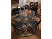 Glass table with chrome legs and chairs