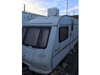Elddis Avante 534 fixed bed with porch awning