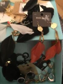 Box of dress rings and feather earrings £5