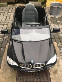 Black BMW X5 electric jeep