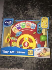Tiny toy driver brand new in box