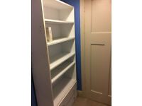 6 foot tall bookcase with some adjustable shelves and 2 lower draws. White.