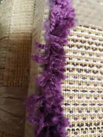 A nrand new still packed violet shaggy rug.